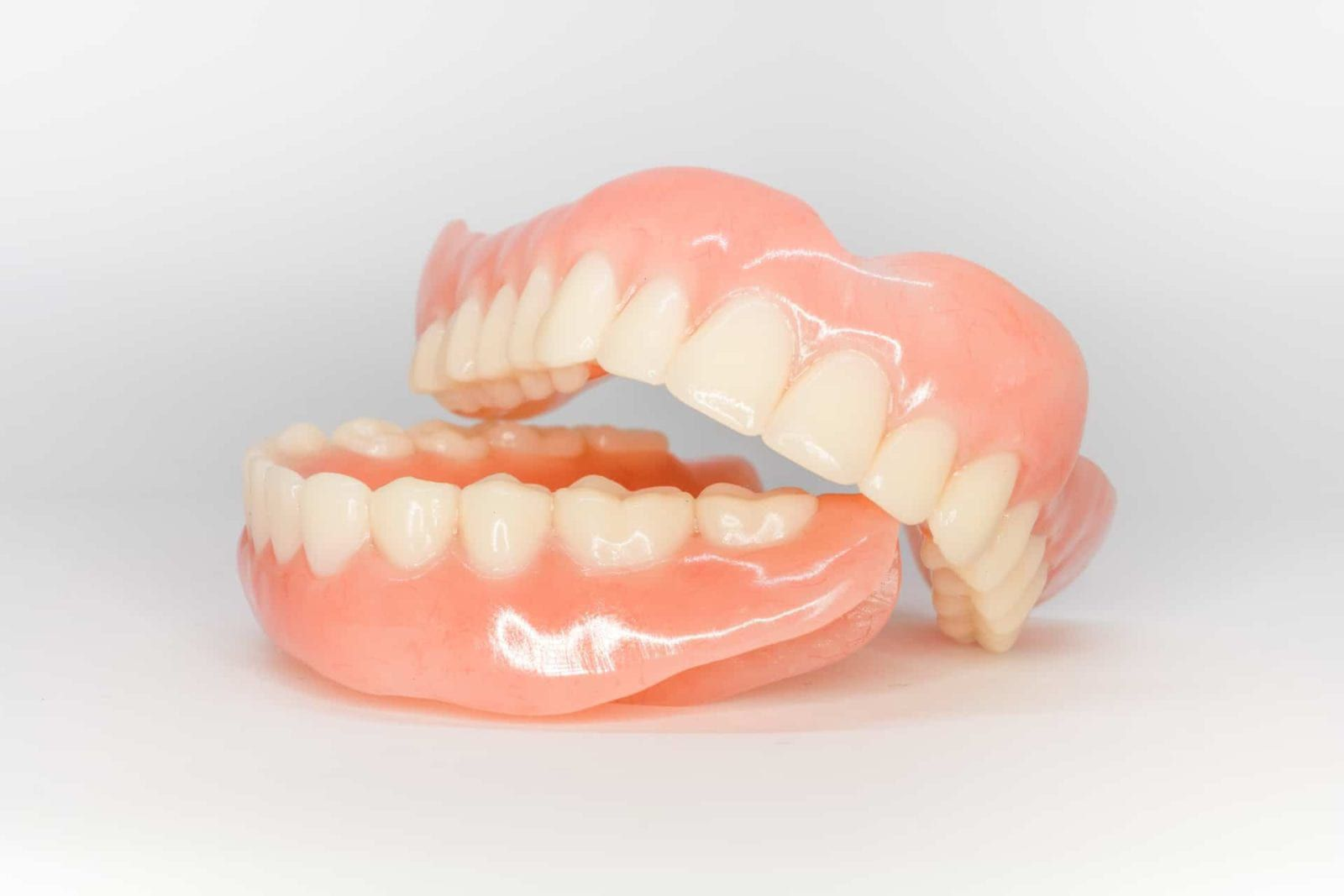 complete denture set on isolated background